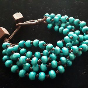 Funky, hand knotted, wooden turquoise bracelet